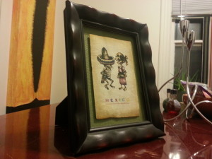 Floated, handmade postcard from Mexico with dancing skeletons